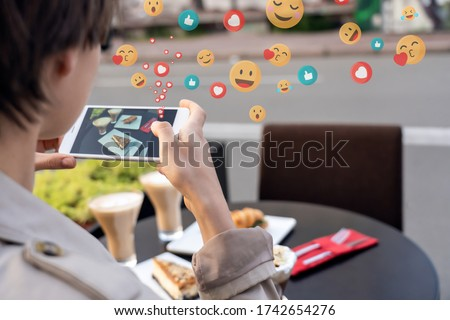 A young girl shooted from back is holding a cell phone and looki Stock photo © d13
