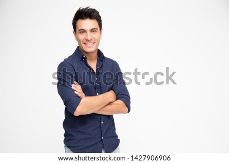 Handsome man looking at camera with arms crossed  Stock photo © wavebreak_media
