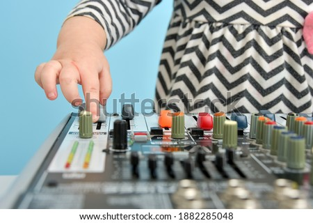 Sound engineer at mixing desk, children performance out of focus Stock photo © zurijeta