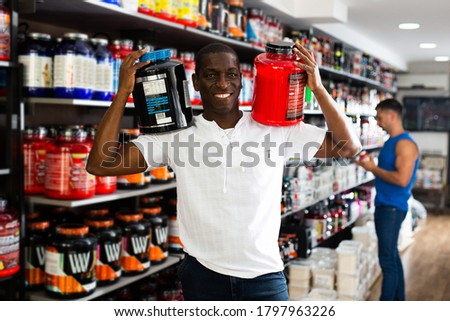 Portrait of confident shirtless man holding nutritional suppleme Stock photo © wavebreak_media