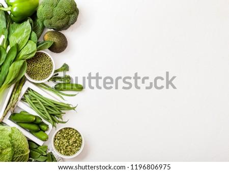 Assorted green toned raw organic vegetables on white background. Avocado, cabbage, broccoli, caulifl Stock photo © DenisMArt