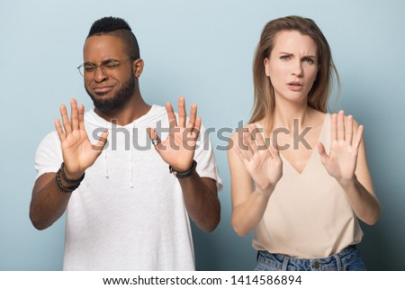 Photo of dissatisfied african american woman showing stop gestur Stock photo © deandrobot