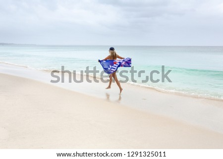 女性 運動 オーストラリア人 フラグ を実行して ビーチ ストックフォト © lovleah