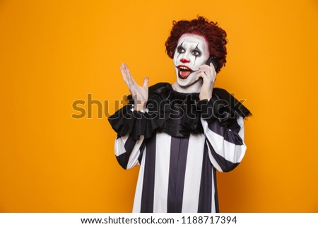 kind clown man 20s wearing black costume and halloween makeup ta stock photo © deandrobot
