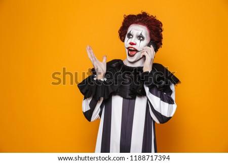 Clown man 20s zwarte kostuum Stockfoto © deandrobot