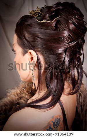 Portrait of pretty long haired brunette woman turned away but looking at camera. Wearing skirt and w Stock photo © studiolucky