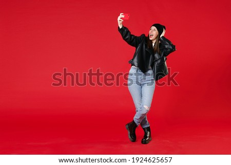 Full length photo of cheerful woman 20s wearing red sweatshirt j Stock photo © deandrobot