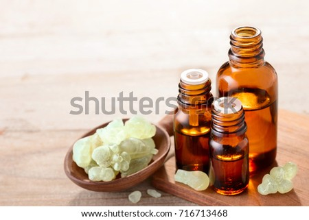 A bottle of frankincense essential oil with frankincense crystals stock photo © madeleine_steinbach