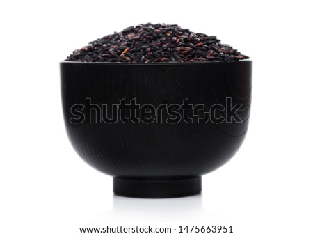 Wooden spoon of raw organic black venus rice on white background.Healthy food.  stock photo © DenisMArt