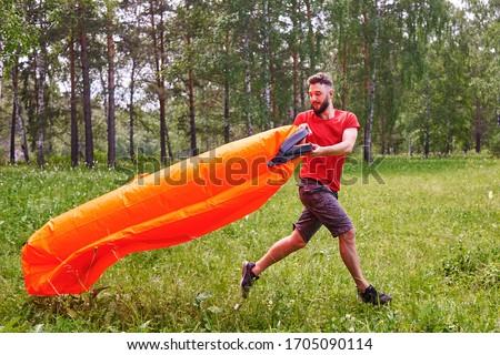 Verano estilo de vida retrato hombre inflable naranja Foto stock © galitskaya