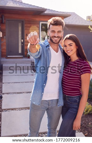Two people holding For Sale sign and keys in front of vignette Stock photo © wavebreak_media