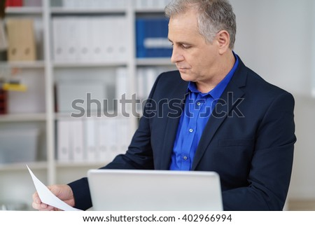 Handsome middle aged worker checking documentation in the factor Stock photo © boggy
