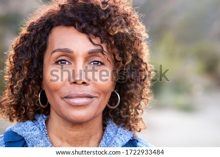 Front view of a thoughtful senior African American woman standing with arms crossed in bedroom at ho Stock photo © wavebreak_media