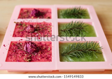 Handmade green soap with conifer in silicone molds and aromatic stuff Stock photo © pressmaster