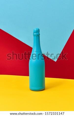 Decoratief geschilderd Blauw champagne fles driekleur Stockfoto © artjazz