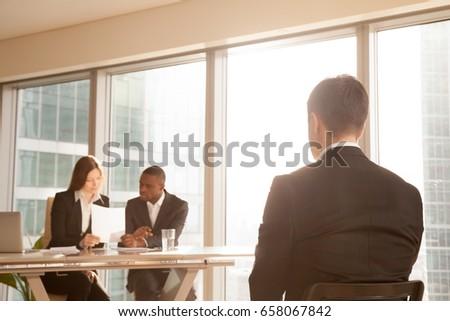 Vista posteriore uomini d'affari conferenza registrazione tavola Foto d'archivio © wavebreak_media