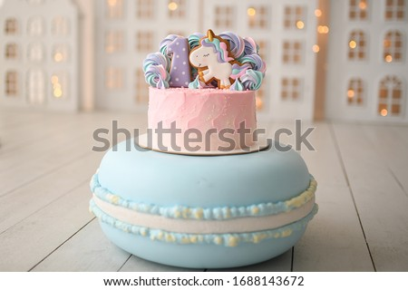 Beautiful bright cake in the form of a unicorn with cream colore Stock photo © dashapetrenko