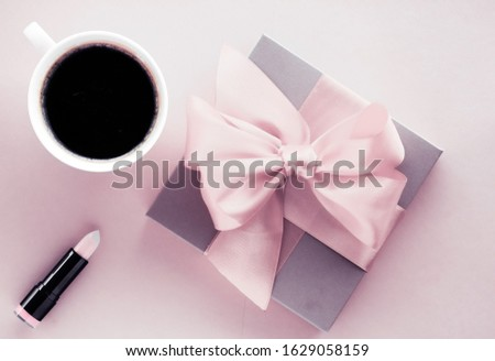 Luxury gift box and coffee cup on pink background, flatlay desig Stock photo © Anneleven