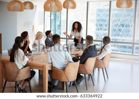 Front view of Multi-ethnic business people working on computer at desk in modern office Stock photo © wavebreak_media
