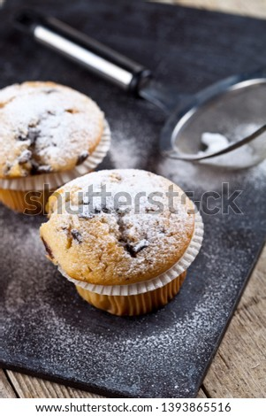 Two fresh homemade muffins with sugar powder and metal strainer  Stock photo © marylooo