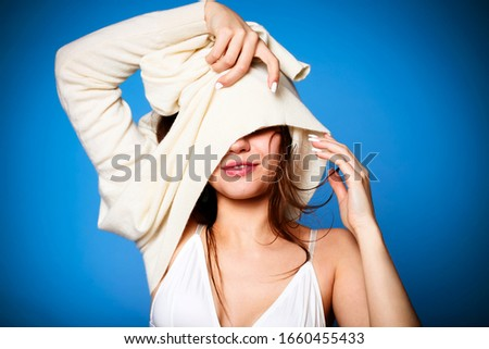 Glad young female smiling and taking off soft and warm sweater a Stock photo © dashapetrenko
