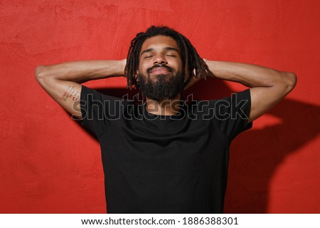Portrait of relaxed unshaven male with closed eyes wears glasses, keeps eyes closed, enjoys calm atm Stock photo © vkstudio