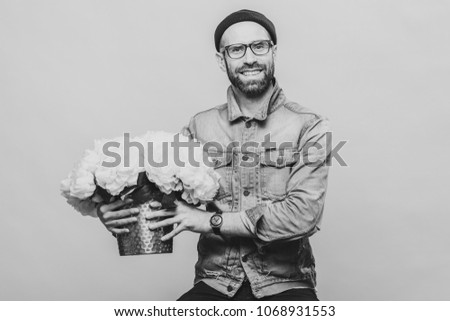 Happy delighted male buys bouquet of flowers for special occasio Stock photo © vkstudio