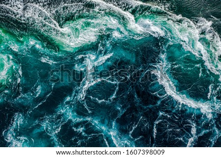 Waves of water of the river and the sea meet each other during h Stock photo © cookelma