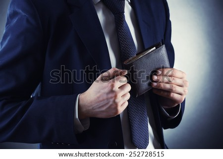Man holding a wallet with money euro in hand in black medical gloves. Stock photo © Illia