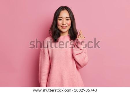 Imagem positivo asiático menina longo cabelo escuro Foto stock © deandrobot