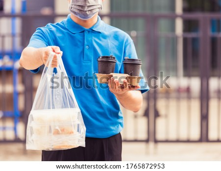 Delivery man in protective mask and gloves, takeaway cup of coffee during the coronavirus epidemic. Stock photo © Illia