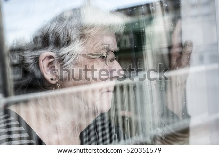 Senior woman looking out through a window like depress Stock photo © Lopolo