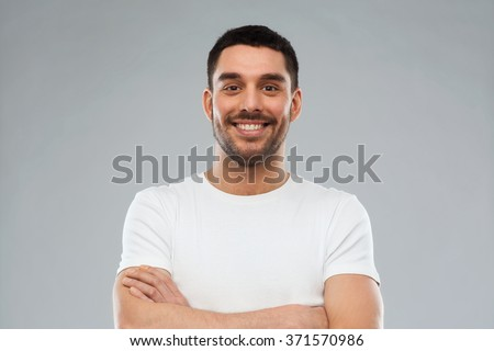 Isolated portrait of smiling young man in casual clothes listening attentively with his palm near ea Stock photo © benzoix