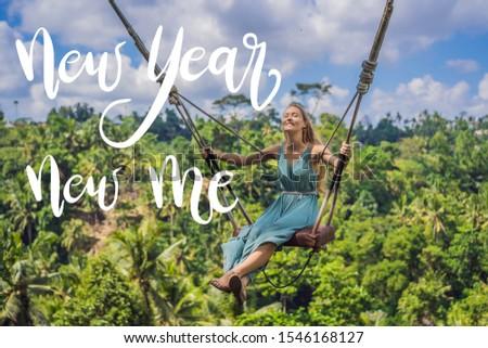 NEW YEAR NEW ME concept Young woman swinging in the jungle rainforest of Bali island, Indonesia. Swi Stock photo © galitskaya