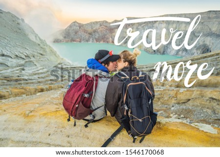 TRAVEL MORE concept Young tourist man and woman sit at the edge of the crater of the Ijen volcano or Stock photo © galitskaya