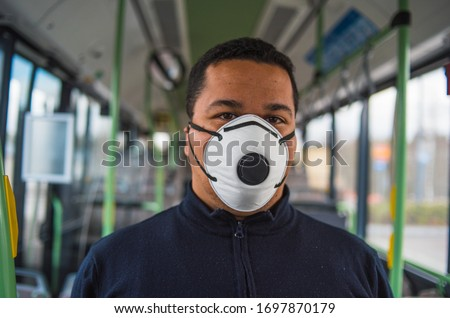 Man passenger wears protective medical glove from coronavirus, touches handrail in subway carriage,  Stock photo © vkstudio