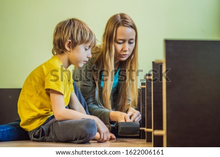 Mother and son assembling furniture. Boy helping his mom at home. Happy Family concept BANNER, LONG  Stock photo © galitskaya