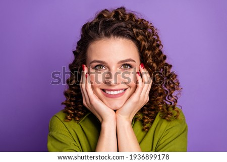 Photo of adorable young millennial female touches cheek gently, enjoys softness of skin after applyi Stock photo © vkstudio
