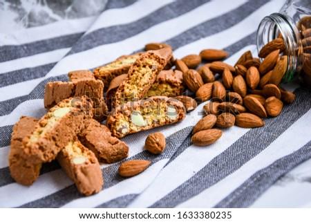 Fresh Italian cookies cantuccini stacks and organic almond seeds Stock photo © marylooo
