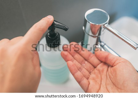 Washing hands with soap how to wash step 2 : squirt liquid from soap bottle dispenser for rubbing ha Stock photo © Maridav