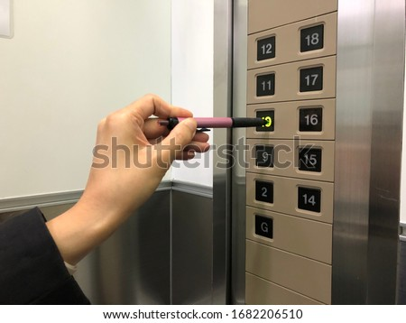 COVID-19 hygiene prevention. Pressing elevator button with finger touching public surface with germs Stock photo © Maridav