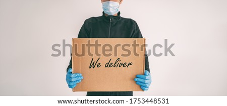 Home delivery WE DELIVER sign on cardboard box banner. Food grocery package online shopping man deli Stock photo © Maridav