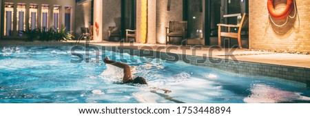Swimming pool of condo buildings re-opening after COVID-19 confinement. Swimmer woman doing crawl in Stock photo © Maridav