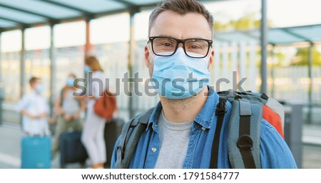 Happy tourists mother, father and son in medical mask on background ofLying Buddha statue Tourists f Stock photo © galitskaya