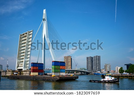 Tug boat towing barge with containers under open bascule part of Erasmusbrug bridge Stock photo © dmitry_rukhlenko