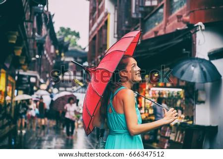 People lifestyle umbrella travel Asian woman shopping in chinatown market street. Rainy day girl tou Stock photo © Maridav