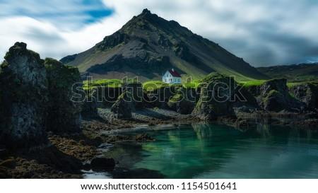 Iceland nature landscape on Arnarstapi Snaefellsnes. Travel photo of woman tourist looking at view o Stock photo © Maridav