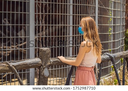 Young woman at the zoo in a medical mask. Visiting public places after the coronavirus epidemic Stock photo © galitskaya
