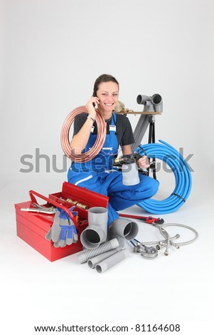 Female labourer speaking on mobile telephone surrounded by equipment Stock photo © photography33