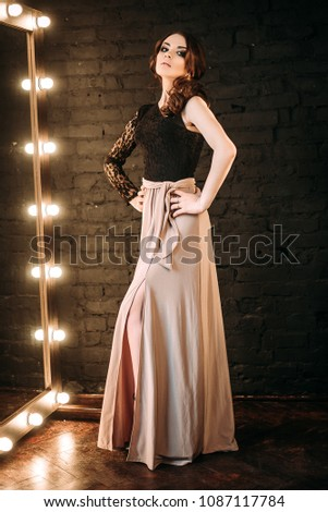 Individuality. Exquisite Modern Woman standing in Black Trendy Dress. Fashion Style Stock photo © gromovataya